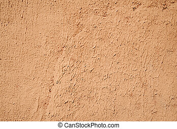 Texture of old wall covered with orange stucco