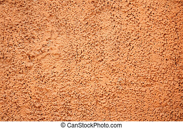 Texture of old wall with orange stucco