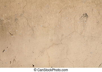 Texture of old wall with yellow stucco