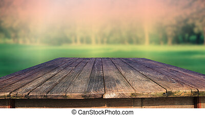texture of old wood table and green park background