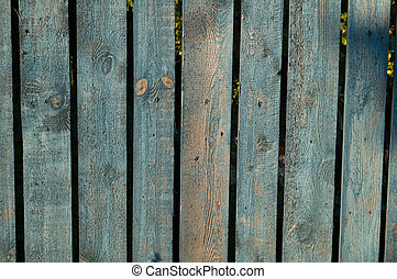 Texture of old wooden fence painted rudely treated blue