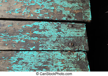 Texture of old wooden panels on the fisherman boat.