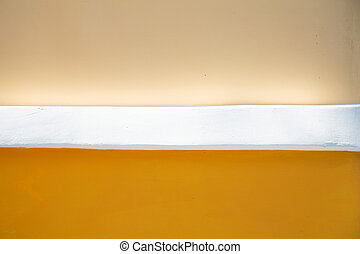 texture of orange-yellow wall with white separator