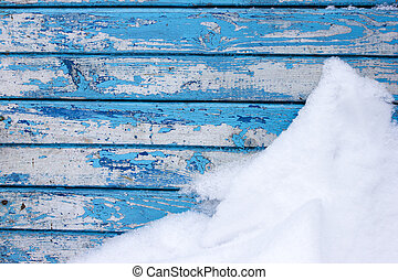 Texture of painted boards in blue and snow. Peeling paint