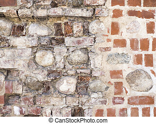 Texture of red damaged brick wall with the old stone background