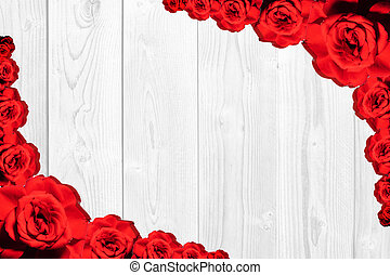 Texture of red roses on a wooden background. Valentines background