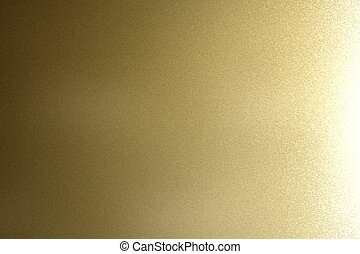 Texture of reflection on rough dark gold metal wall, abstract background