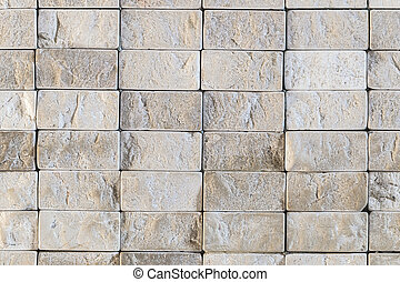 Texture of repeating small gray stones wall