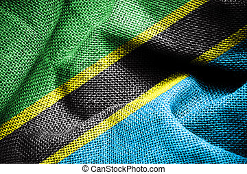 Texture of sackcloth with the image of Tanzania Flag