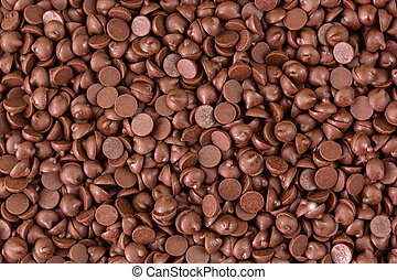 Texture of small chunks of sweetened chocolate chips...