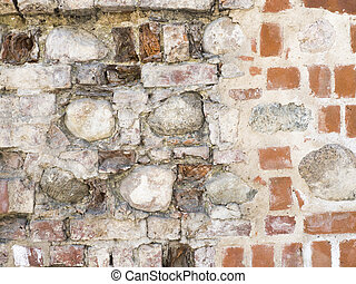 Texture of the old damaged red brick wall with stone background