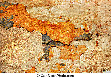 texture of the old stucco wall with cracks