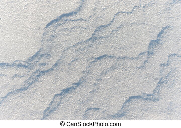 texture of the snow cover on the beach on a sunny day