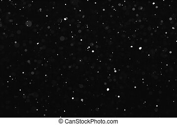Texture of the snow falling on a black background