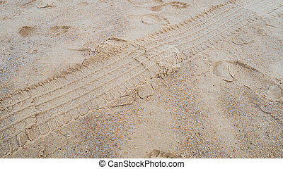 Texture of tire form car or truck on sand and beach