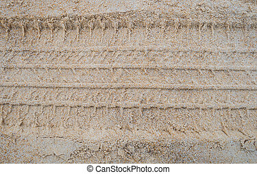 Texture of tire form car or truck on sand and beach.