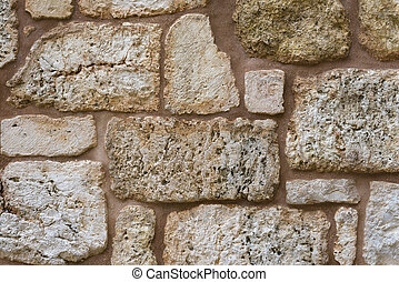 Texture of wall made of unevenly cut Jerusalem stones.