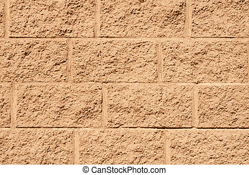 Texture of wall with yellow stucco