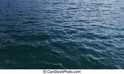 Texture of water. Adriatic Sea near Montenegro. Transparent blue