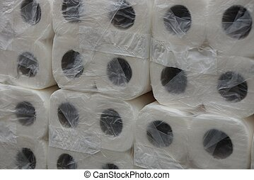 texture of white rolls of toilet paper in cellophane packaging
