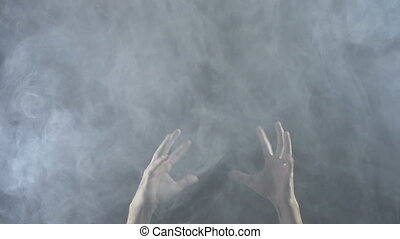 Texture of white vapor mist with hands, 4k - White smoky...