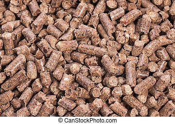 Texture of woody clumps, pellets of  litter, for cat, rabbit, guinea pig, hamster, rodent, bird, turtle and other pets.