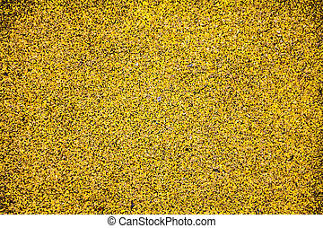Texture of yellow color rubber floor on playground.