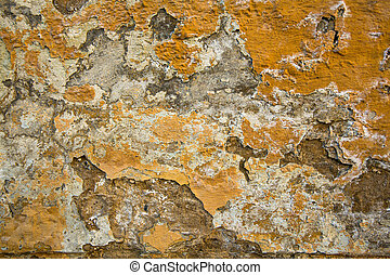 Texture paint on a crumbling of the old stucco wall stone house.