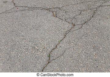 Texture with cracks on asphalt background