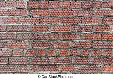 Textured background of red brick wall