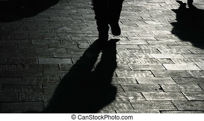 Textured background with the shadow of people on street