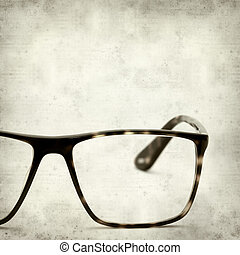 textured old paper background with reading glasses