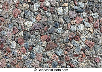 Textured pebble sidewalk background.