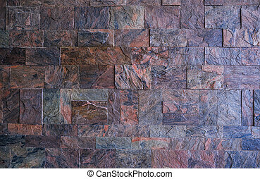 Textured wall made of granite stone background.