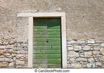 Textured wall with green door