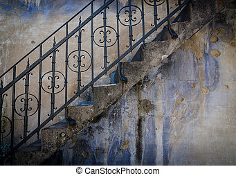 Wall with grundge stains and texture with stairs