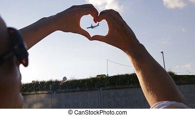 tha airplane in a hand heart