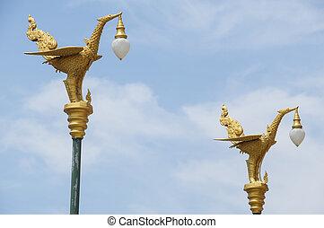 Thai art swan on lamp post.