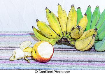 Thai Bananas and Apple Still Life, bite Banana and Apple