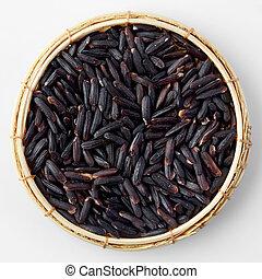 Thai black jasmine rice (Riceberry)in bamboo basket isolated on white