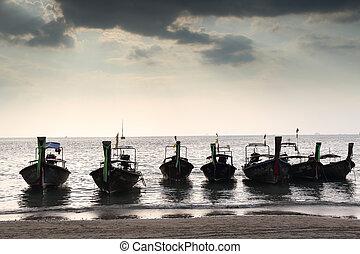 Thai boat in sunset