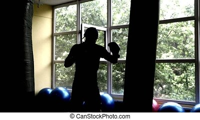 Thai Boxing training young European man in the gym. 4k, slow...