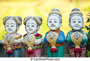 Thai children stucco doll salute.