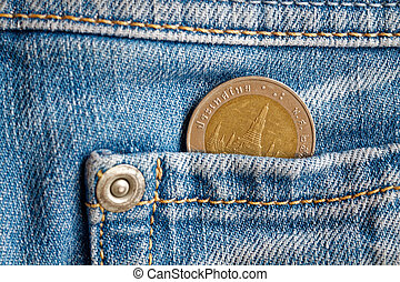 Thai coin with a denomination of 10 baht in the pocket of light blue denim jeans