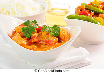 Delicious and colorful bowl of thai curry chicken.