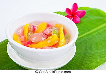 Thai Dessert (ruam mit) colorful ball flour, coconut, milk, jackfruit and truffle