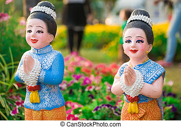 Boy and girl in thai culture greeting we call wai and say thai doll is in garden m4hsunfo Gallery