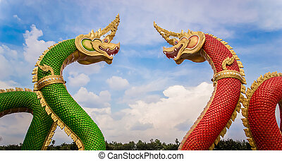 Thai dragon or king of Na-ga statue on blue sky background.