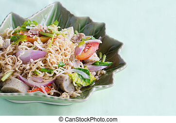 Thai dressed spicy salad with pork, tomatoes and noodle.