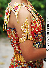Thai female in bright traditional dress - Close-up of a Thai...